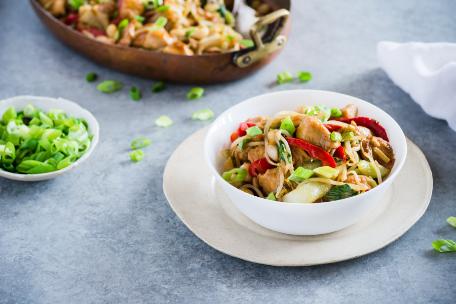 Asian style chicken with veggies in a bowl