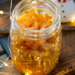 Candied orange peel in a jur with festive lights around