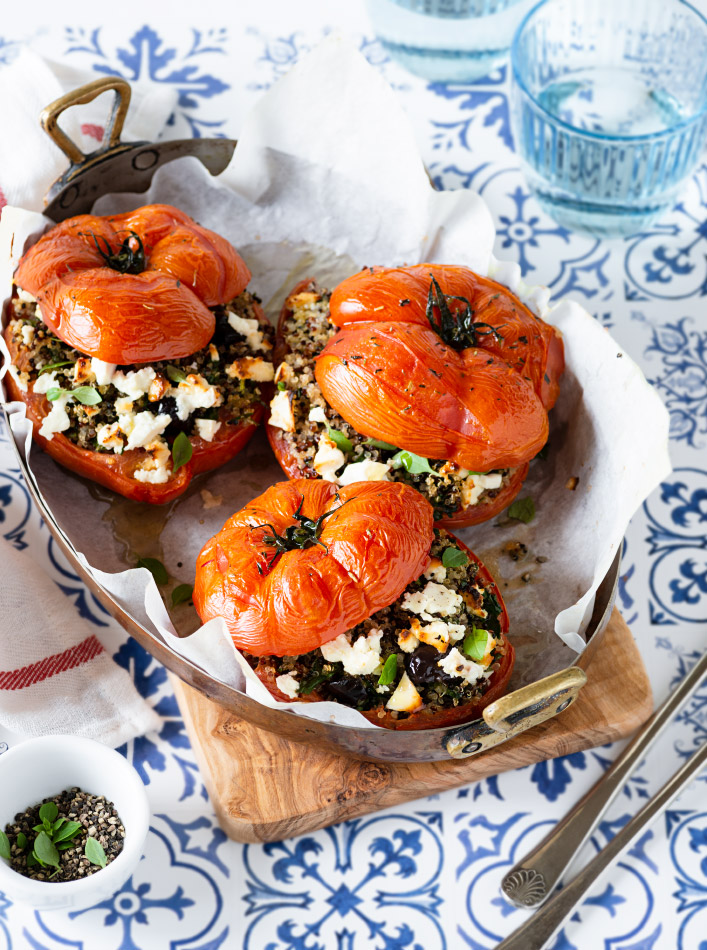 Quinoa stuffed tomatoes in a baking dish